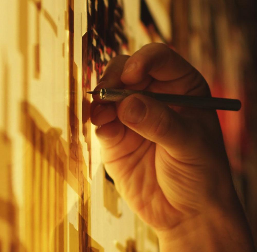 Streetartist Max Zorn making tape-art at Scope international contemporary art show